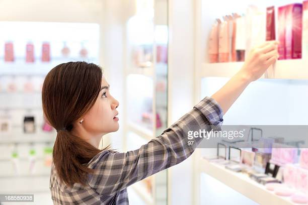 Asian woman shopping in the store cosmetics.