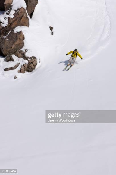 Asian woman skiing downhill
