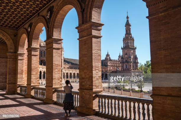 Asian Woman Takes A Photo With Her Smartphone Of The Buildings In The Plaza De Espana In Andalusia Sevillia Seville Spain
