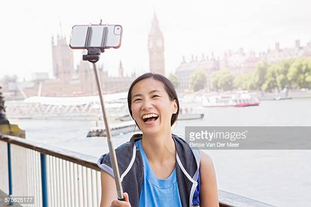 asian woman takes selfie near big ben and thames - tourist stock pictures, royalty-free photos & images