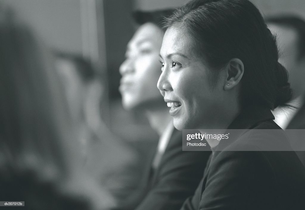 Asian woman talking during meeting : Stock Photo