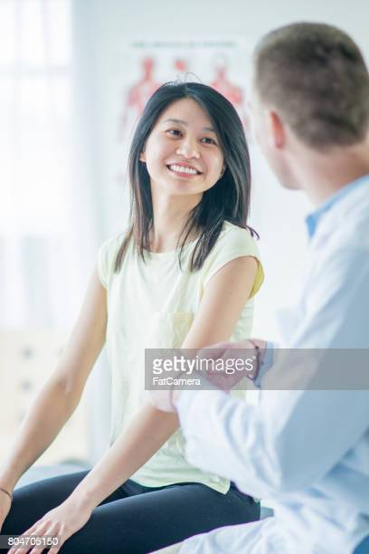 Asian Woman Talking to Doctor