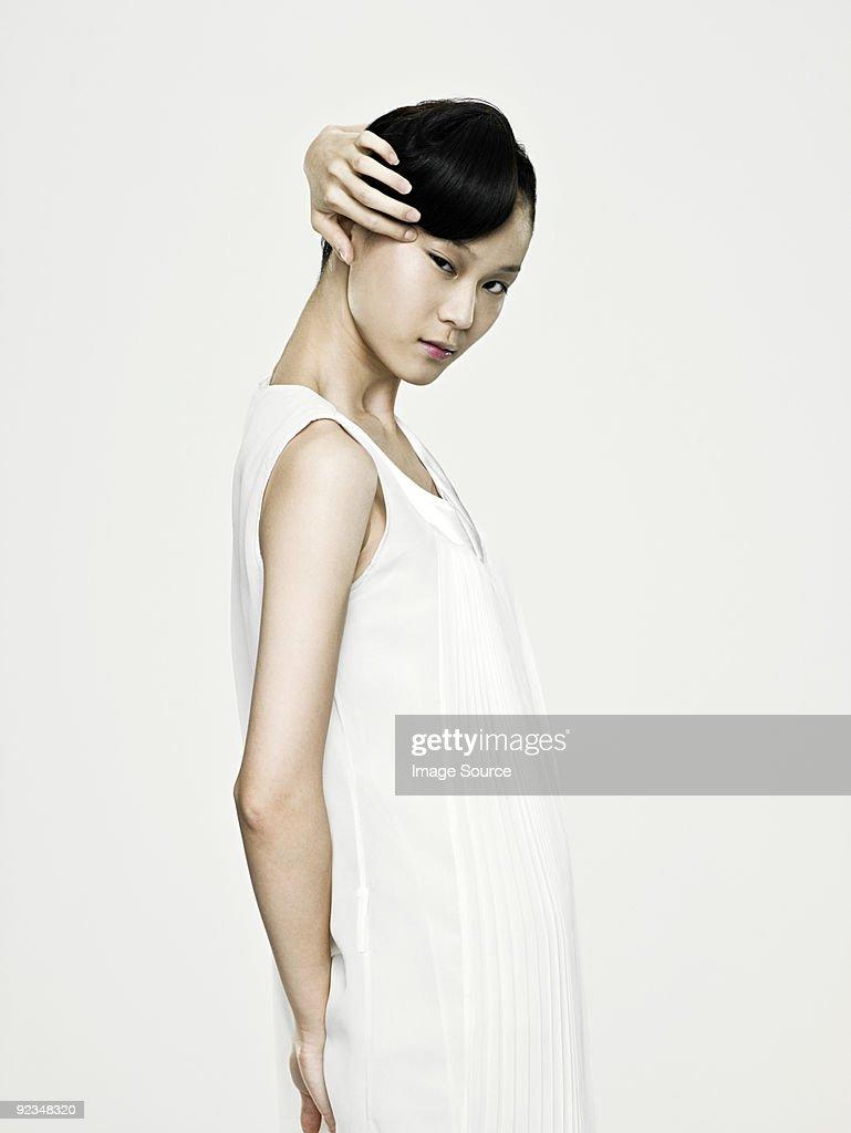 Asian woman touching her eye : Stock Photo