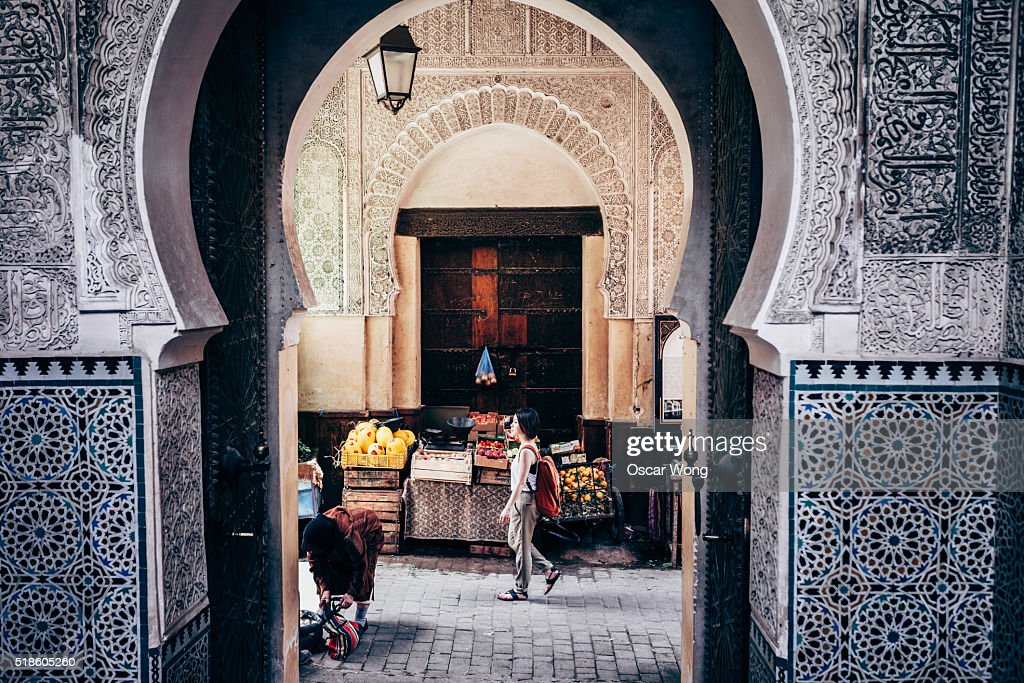 Asian woman tourist getting around in Marrakesh : Stock Photo