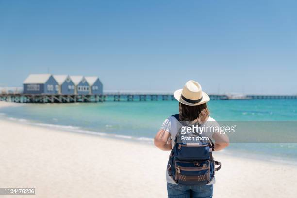 asian woman traveler sightseeing at busselton jetty on a sunny day in busselton, western australia, australia. - jetty stock pictures, royalty-free photos & images