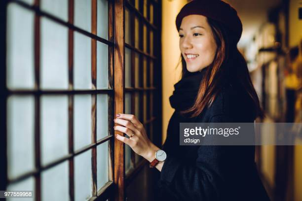 asian woman traveller sightseeing and visiting traditional japanese house - 宿屋 ストックフォトと画像