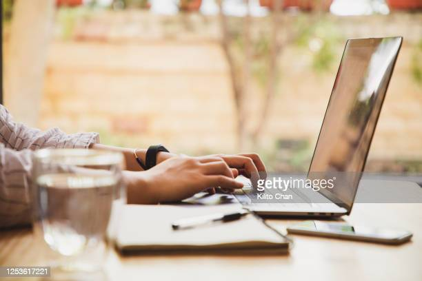 asian woman using a laptop at home - 職探し ストックフォトと画像