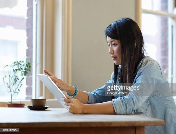 Asian woman using digital tablet.