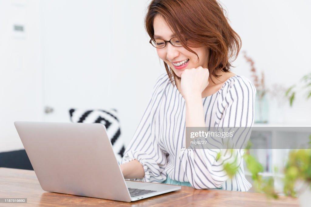 asian woman using laptop : Stock Photo