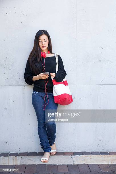 Asian woman using smart phone.