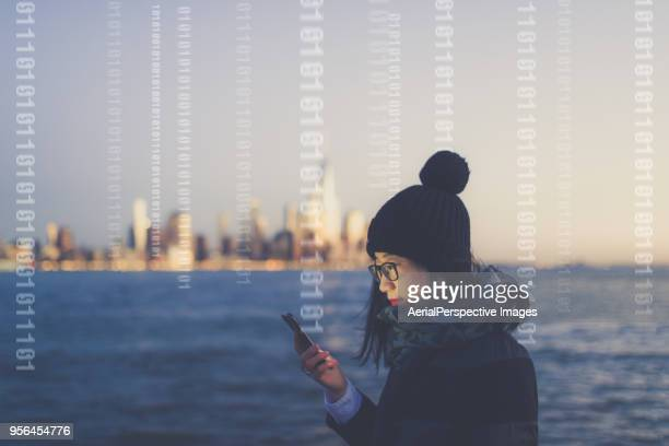 asian woman using smartphone at dusk - binary code stock pictures, royalty-free photos & images