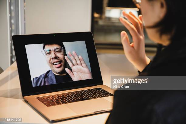 asian woman video conference with asian man - interview stock pictures, royalty-free photos & images