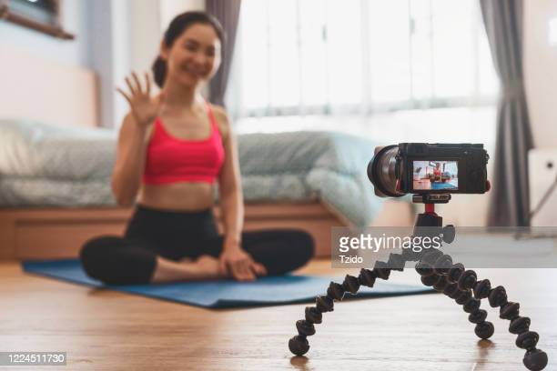 camera taking video live asian woman