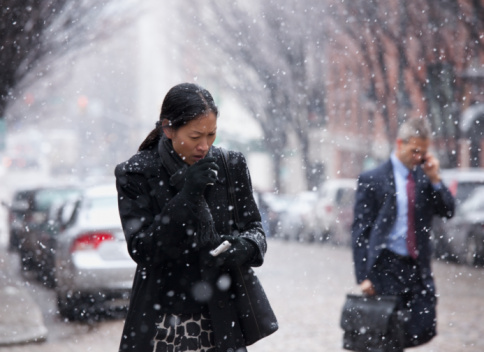 Asian woman walking in snow and coughing - gettyimageskorea