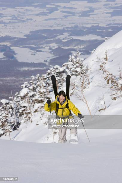 Asian woman walking in snow