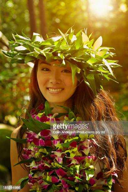 asian woman wearing traditional garb - hawaiian lei stock pictures, royalty-free photos & images