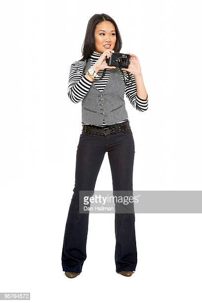Asian woman with camera on white background.