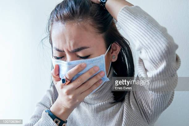 asian woman with face mask protection of coronavirus in human lungs - cough stock pictures, royalty-free photos & images