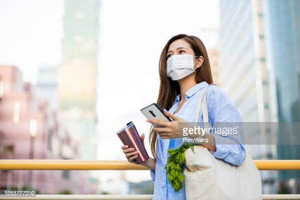 asian woman with facial mask - reusable bag stock pictures, royalty-free photos & images