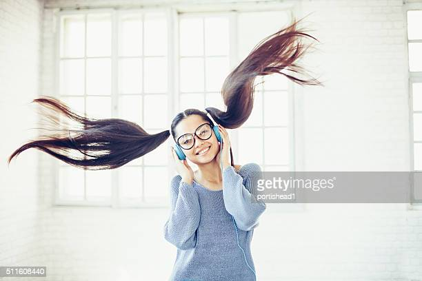 Asian woman with headphones listening to music
