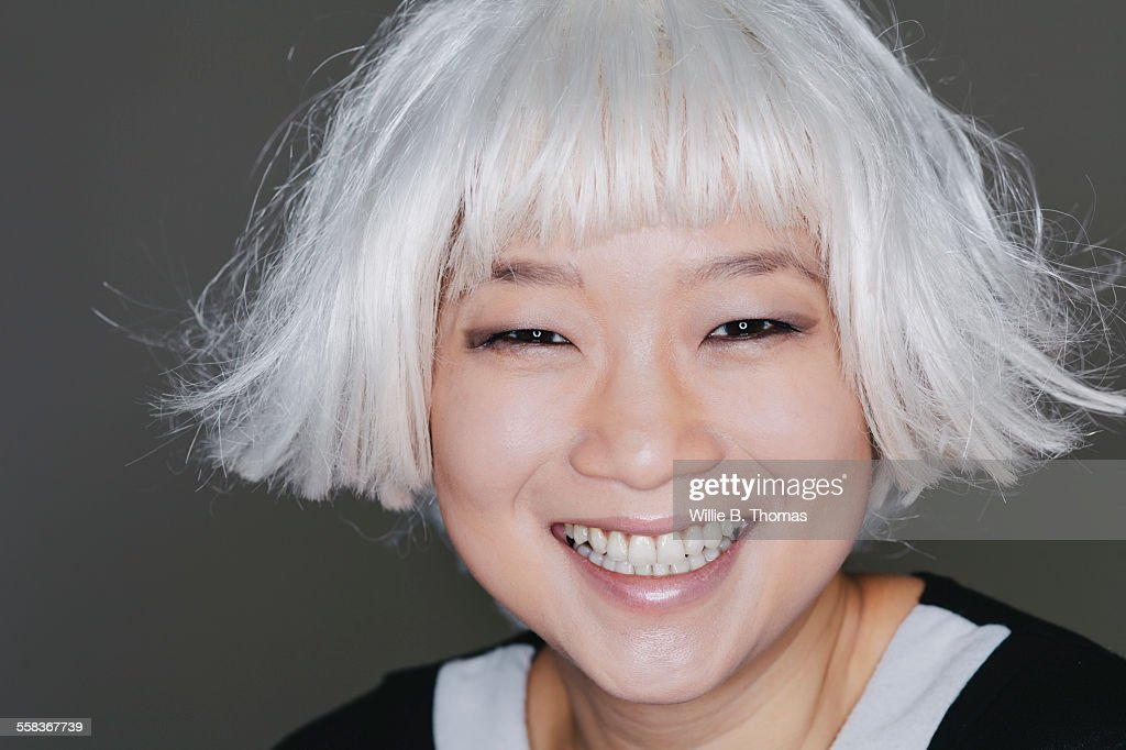 Asian woman with platinum blond hair : Stock Photo