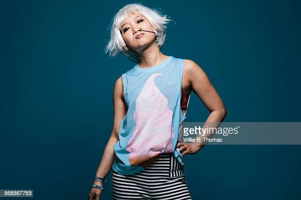 Asian woman with platinum blond hair