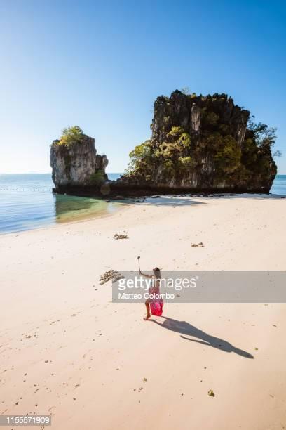 asian woman with selfie stick at hong island, thailand - railay strand stock-fotos und bilder
