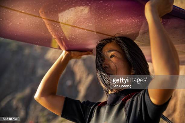 asian woman with surfboard - california stock pictures, royalty-free photos & images