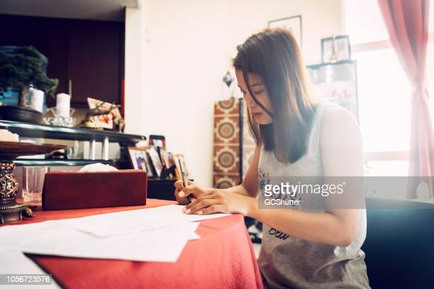 asian woman working from home - daily life in philippines stock pictures, royalty-free photos & images