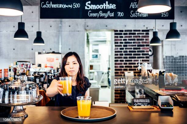 Asian woman working in cafe