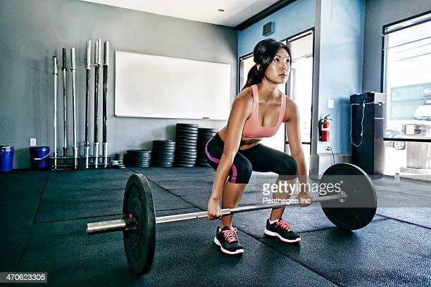 asian woman working out in gym - barbell stock pictures, royalty-free photos & images