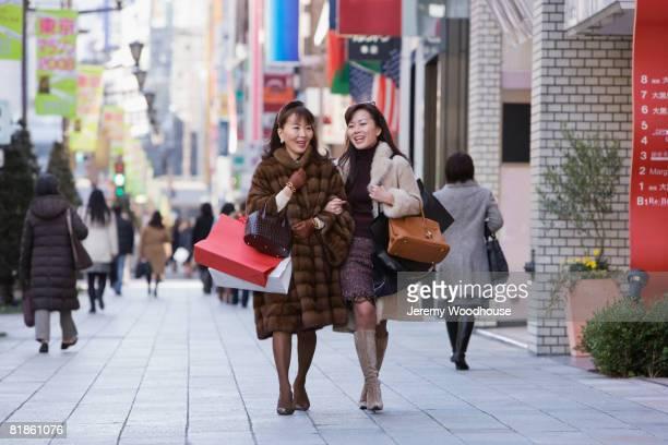 Asian women carrying shopping bags