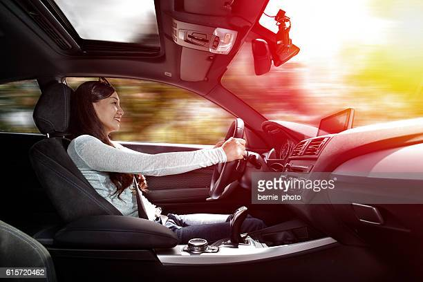 Asian women driving car