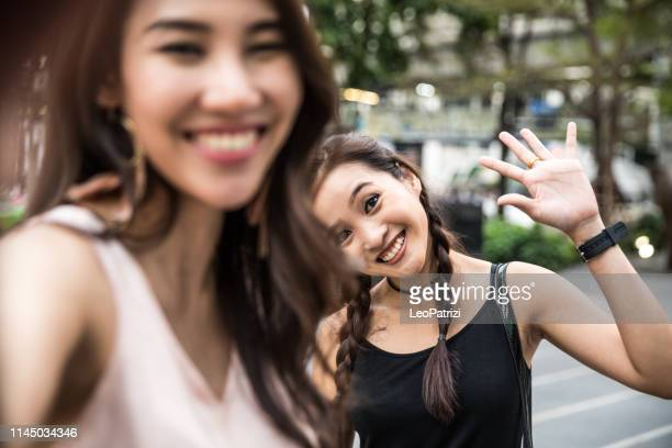 asian women friends in the city - only young women stock pictures, royalty-free photos & images