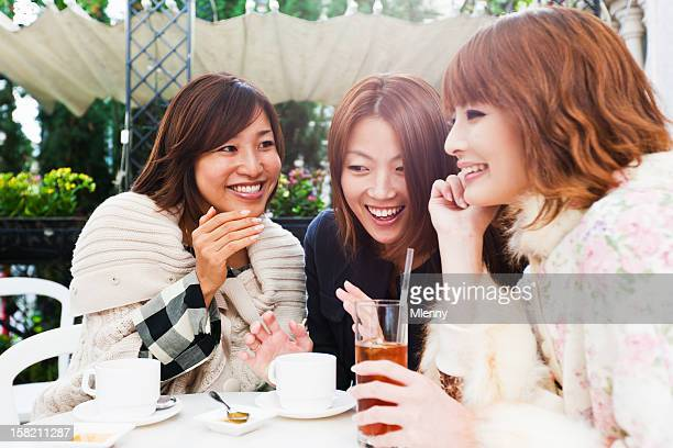 Asian Women Fun in Street Cafe on a Sunny Day