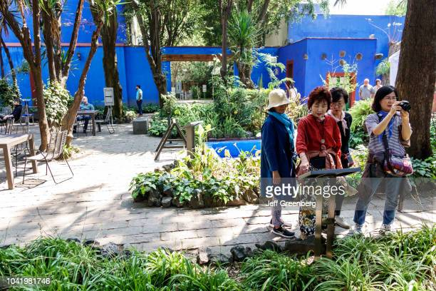Asian women in the central courtyard at the Frida Kahlo Museum