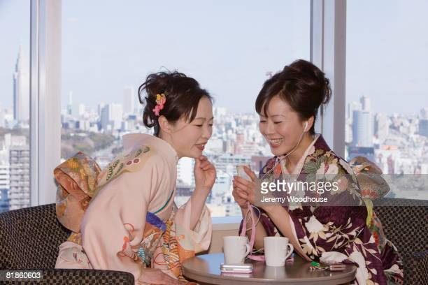 Asian women listening to mp3 player