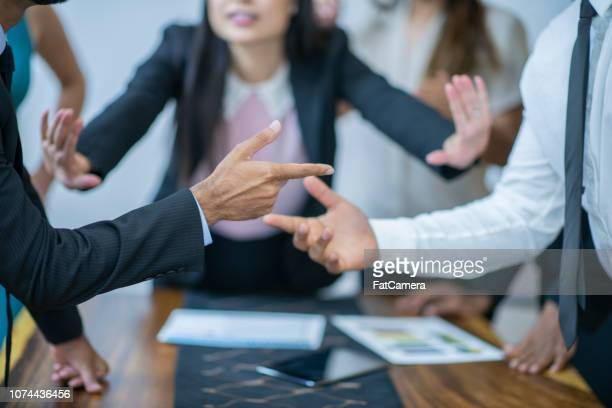 asian women mediating disagreement - fighting stock pictures, royalty-free photos & images