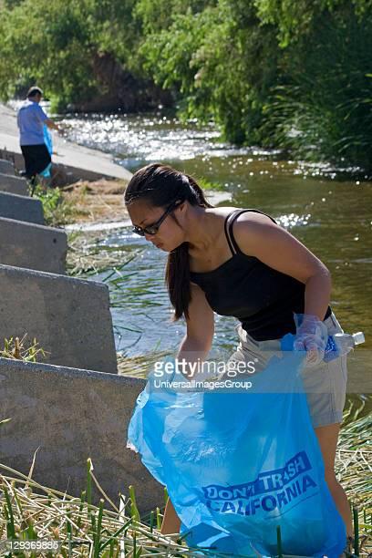 Asian Women picking up trash in LA River. FoLAR's annual 'La Gran Limpieza' clean up of the Los Angeles River. Bette Davis Picnic Area. Glendale...
