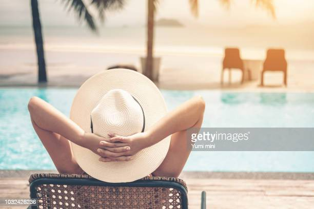 asian women relaxing in swimming pool summer holiday on beach - asian women feet stock pictures, royalty-free photos & images