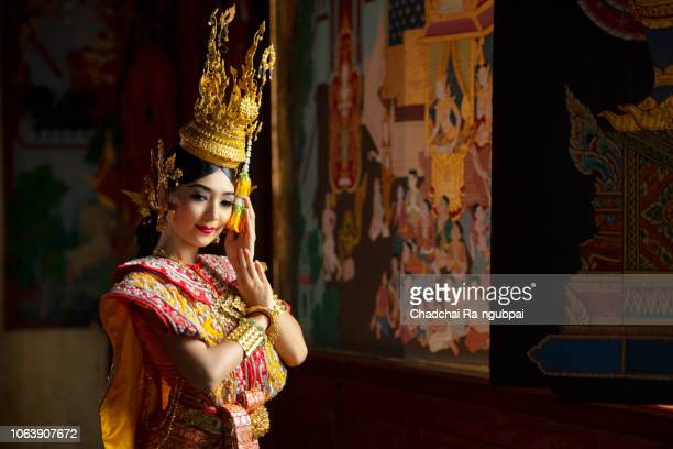 asian women wearing a khon that is a culture of thailand. - hindu god stock pictures, royalty-free photos & images