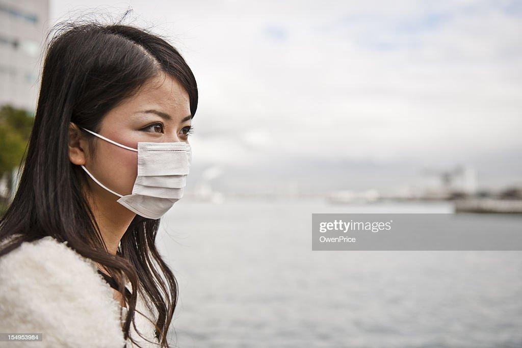 Asian Women wearing facemask : Stock Photo