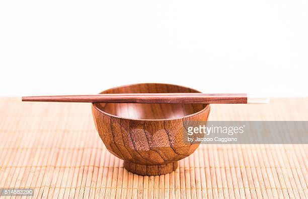 Asian wooden rice bowl with sticks
