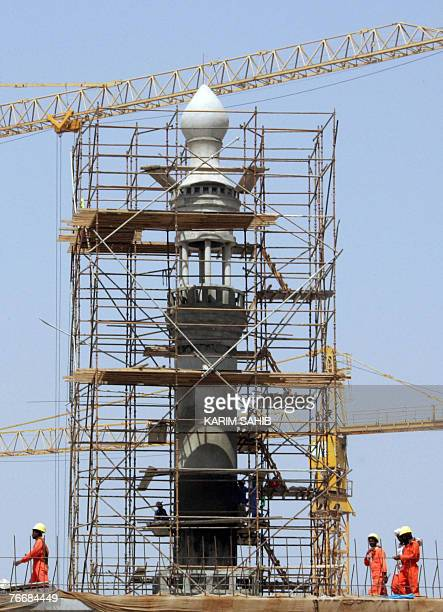 Asian workers are seen at the construction site of a new mosque ahead of the holy fasting month of Ramadan in the Gulf emirate of Dubai 12 September...