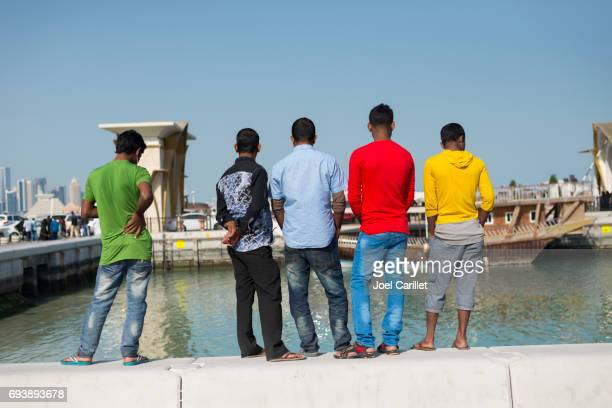 asian workers in doha, qatar - migrant worker stock photos and pictures