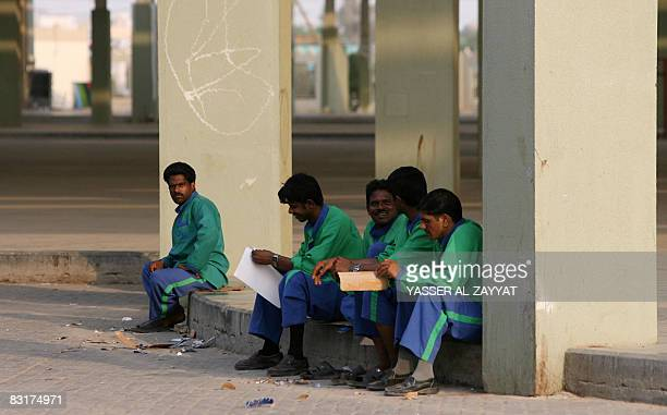 Asian workers take a break at Friday Market in Kuwait City on September 9 2008 The Kuwaiti parliament's human rights committee has called for a...