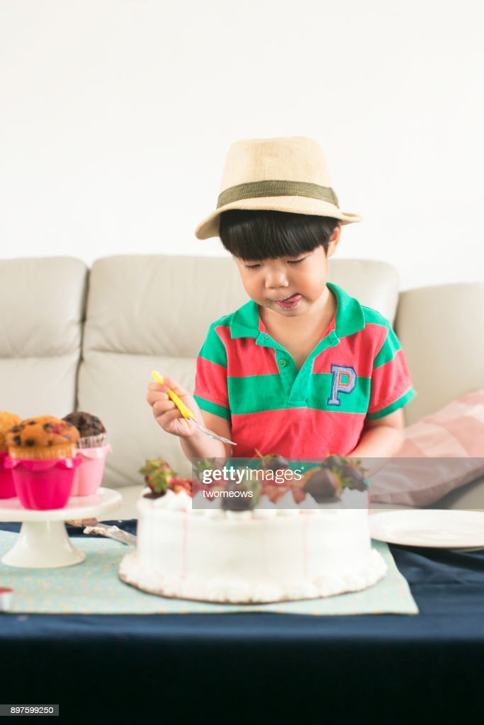 Asian Young Boy Eating Birthday Cake Stock Photo Getty Images