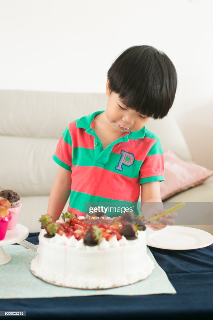 Prime Asian Young Boy Eating Birthday Cake High Res Stock Photo Getty Funny Birthday Cards Online Inifofree Goldxyz