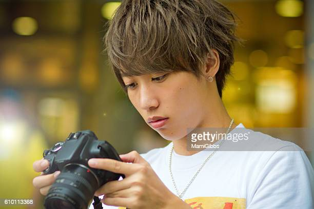 Asian young boy with the camera