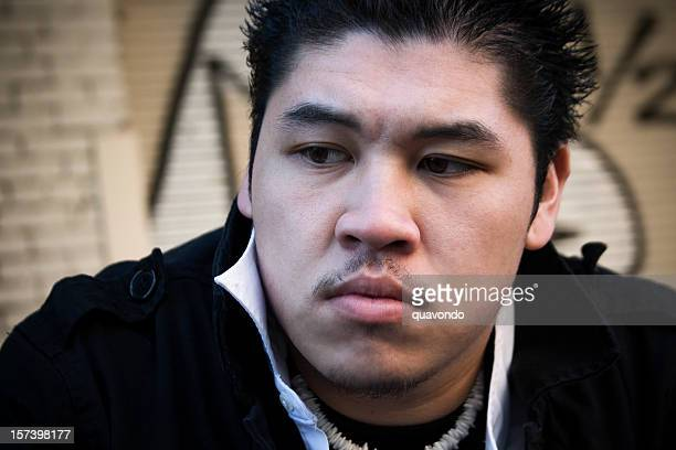 Asian Young Man Portrait Outside, Graffiti Wall in Background